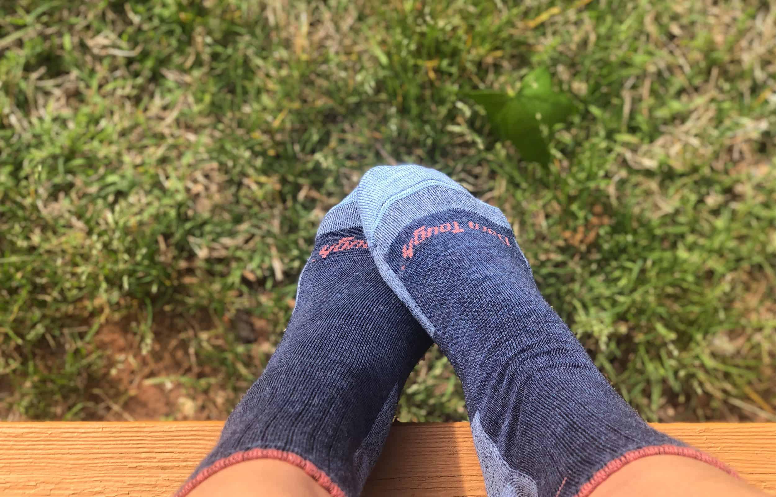 close up view of darn tough blue socks