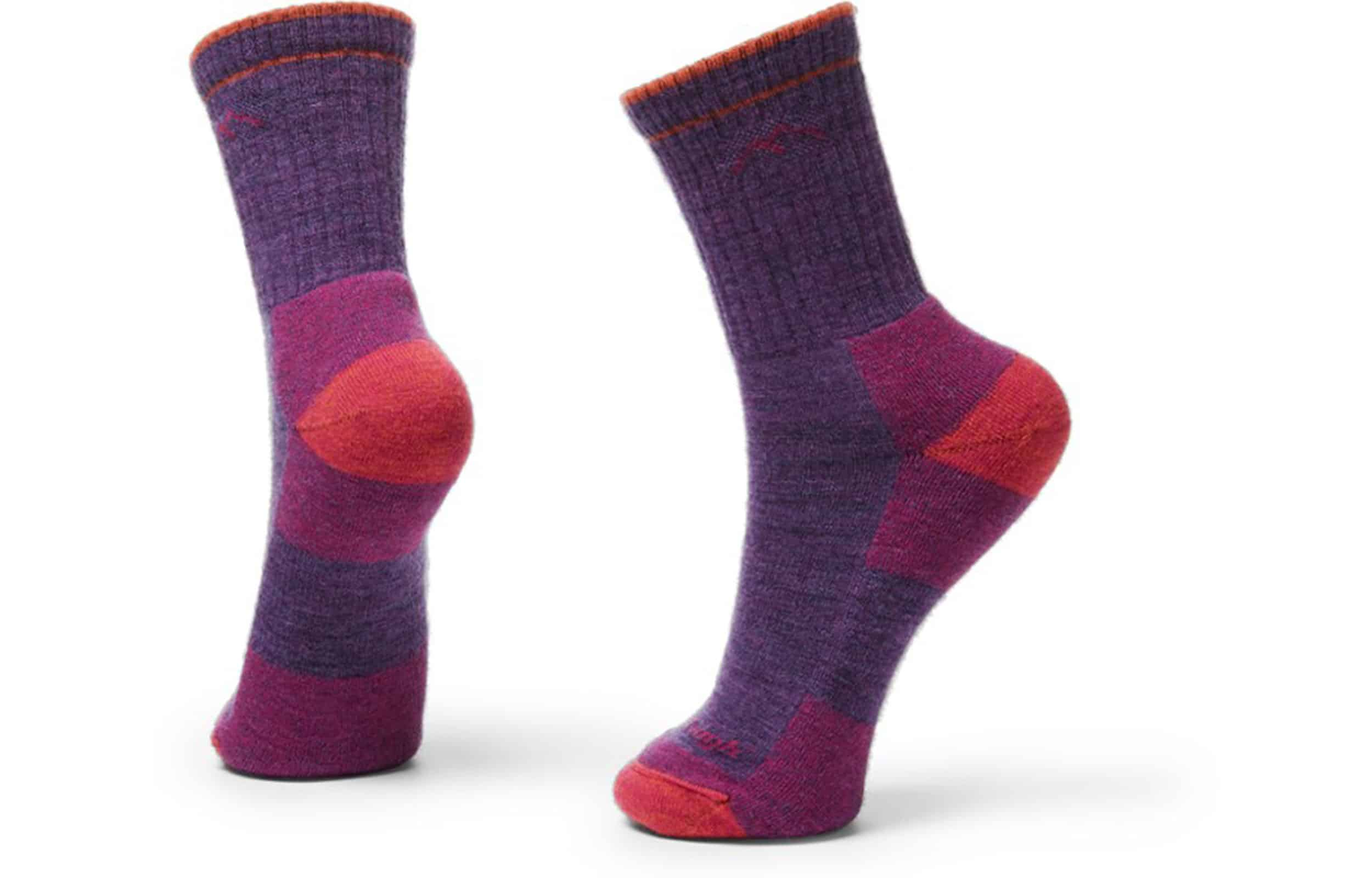 a pair of pink and purple darn tough socks