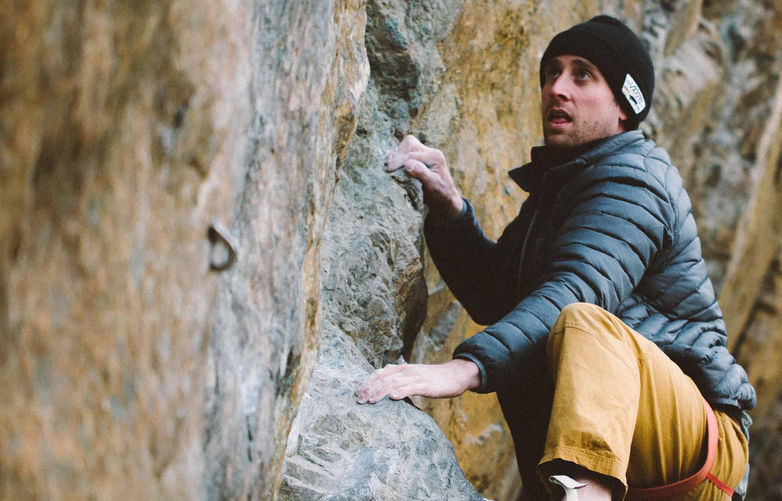 climber wearing an insulated jacket