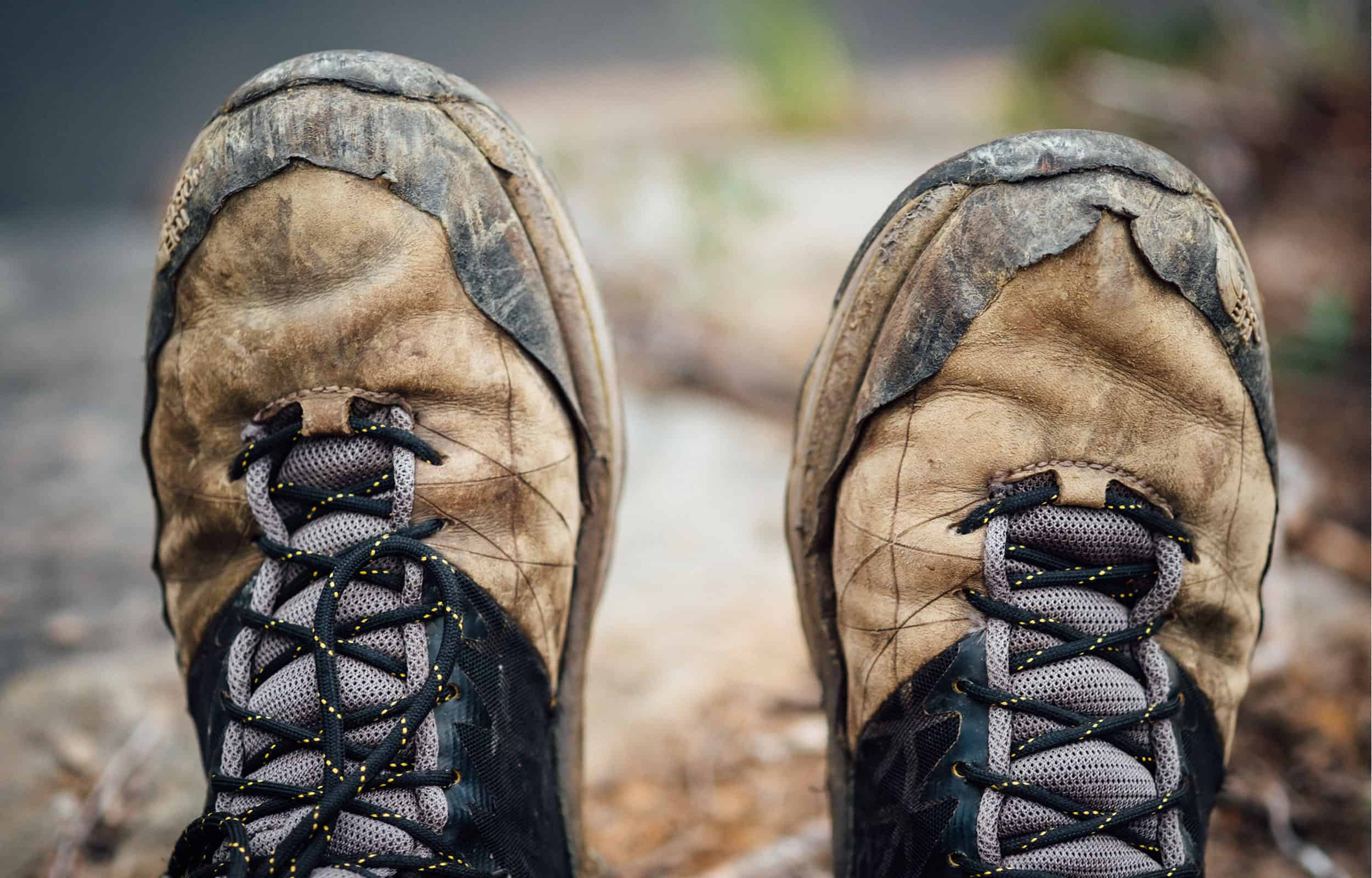 close up of a dirty pair of hiking boots