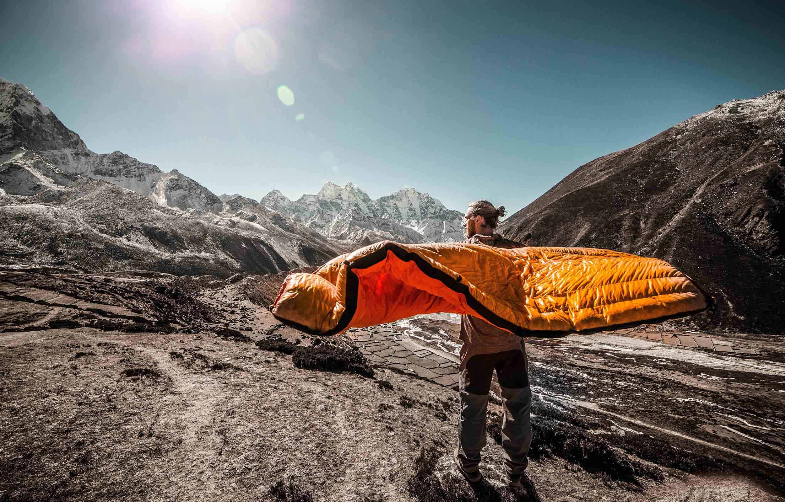 man airing out sleeping bag to repair