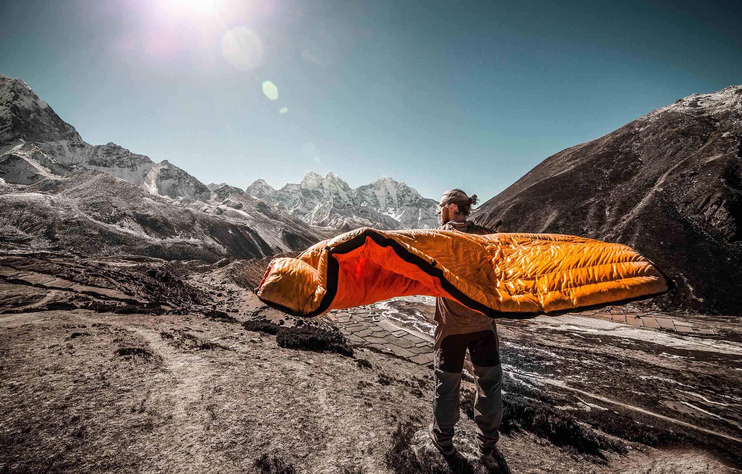 man airing out sleeping bag to repair
