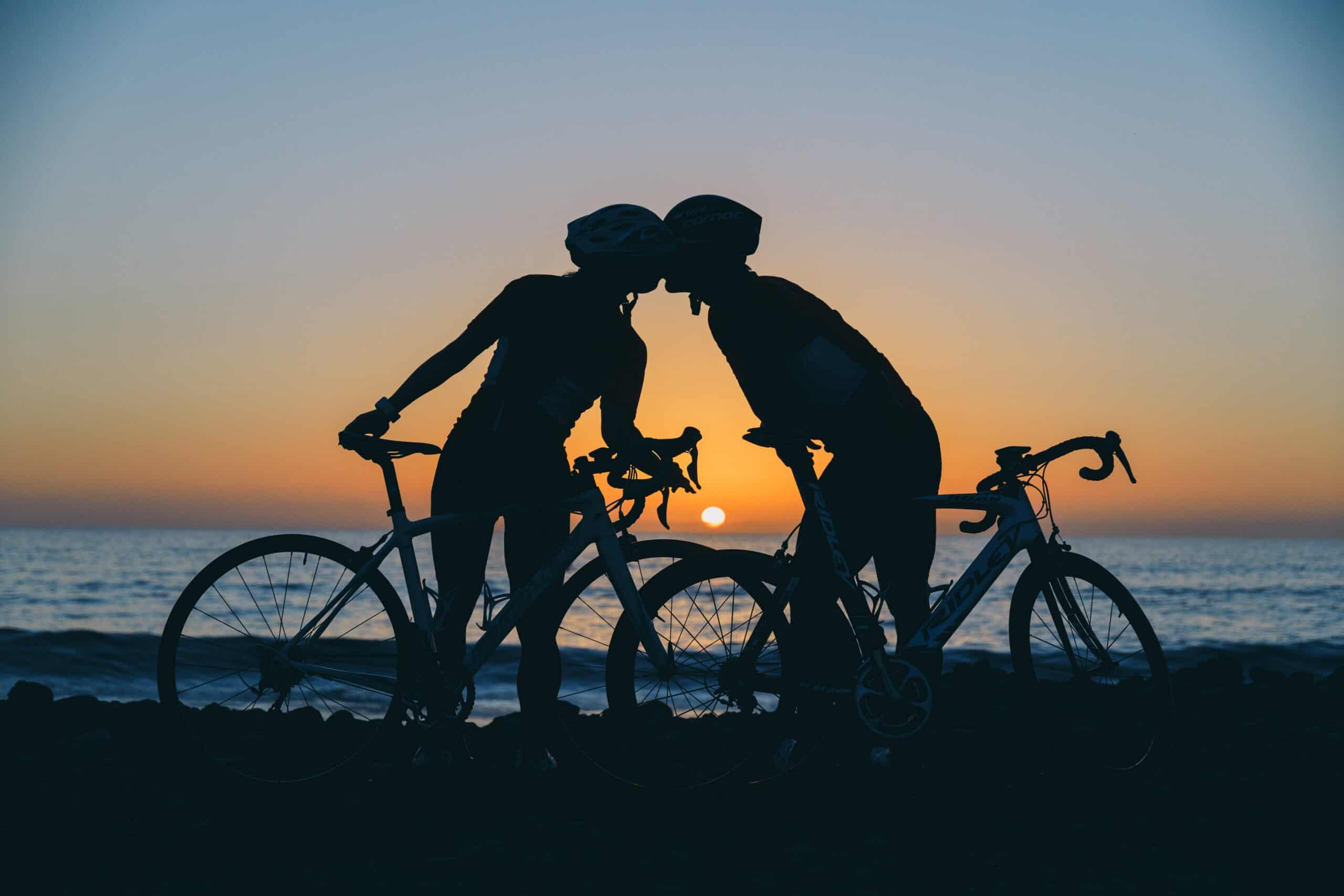 cyclists kissing sunset