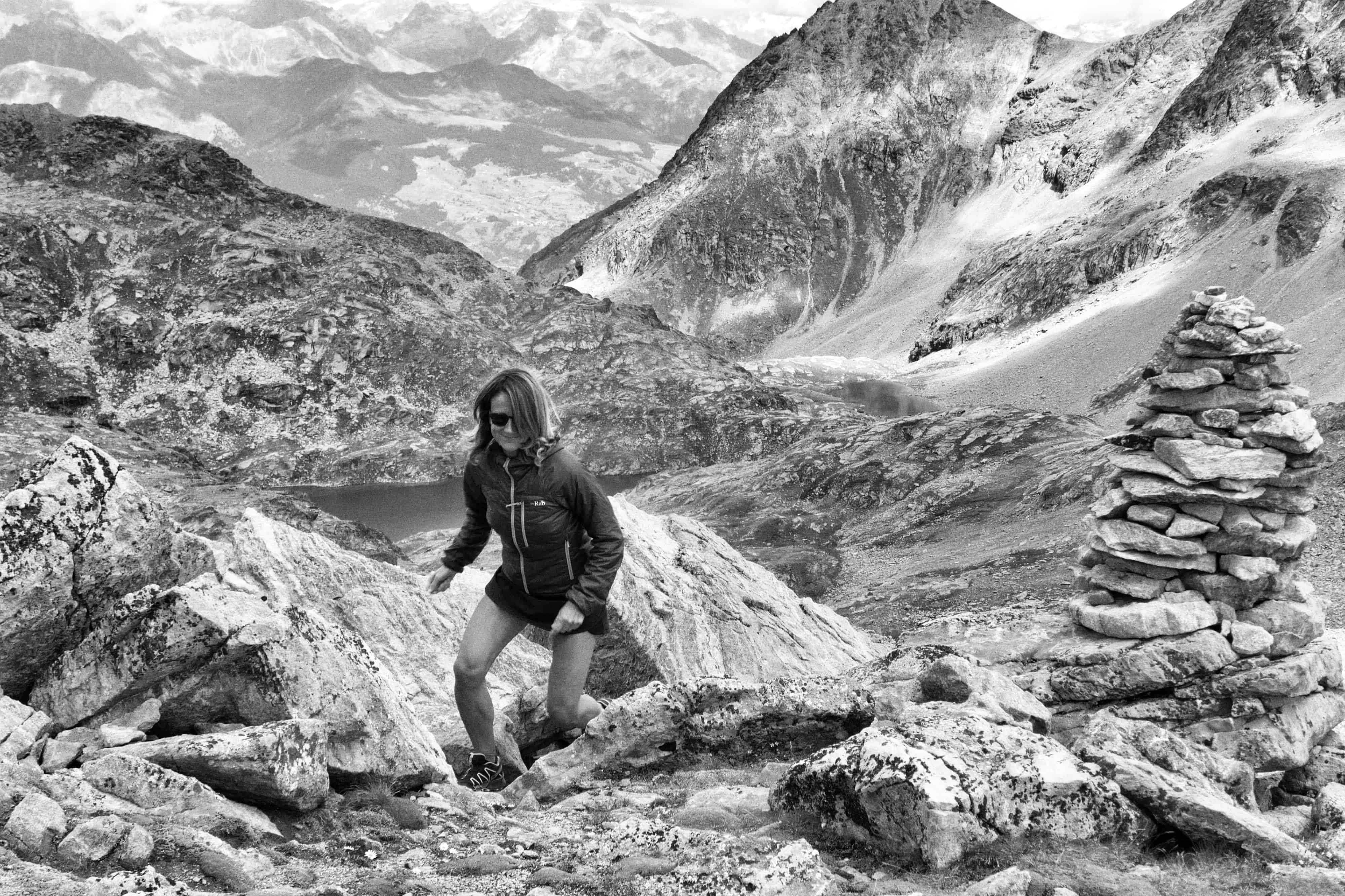 Trail running girl mountaint