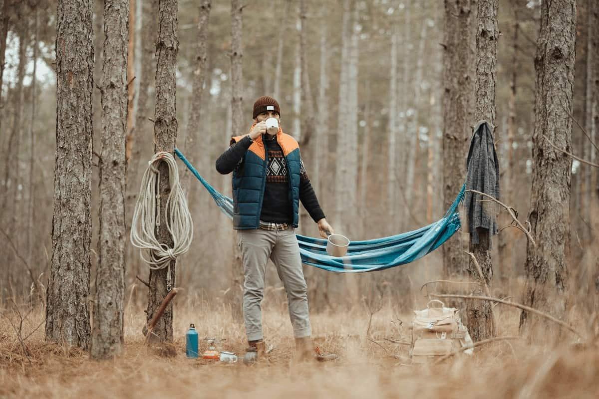Man camping coffee hammock