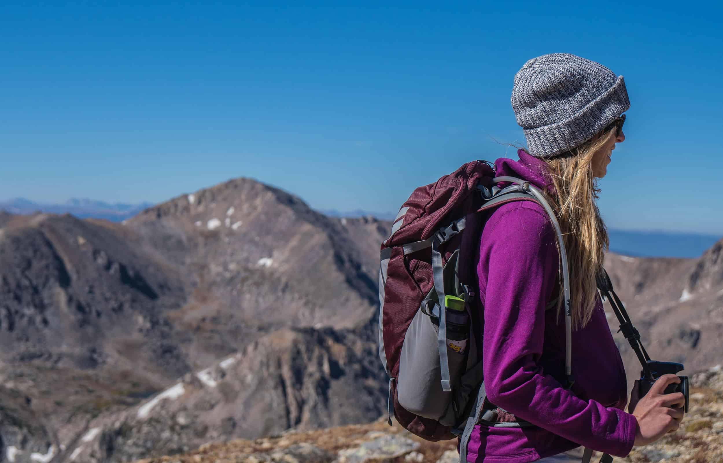 girl hiking and wearing a backpack