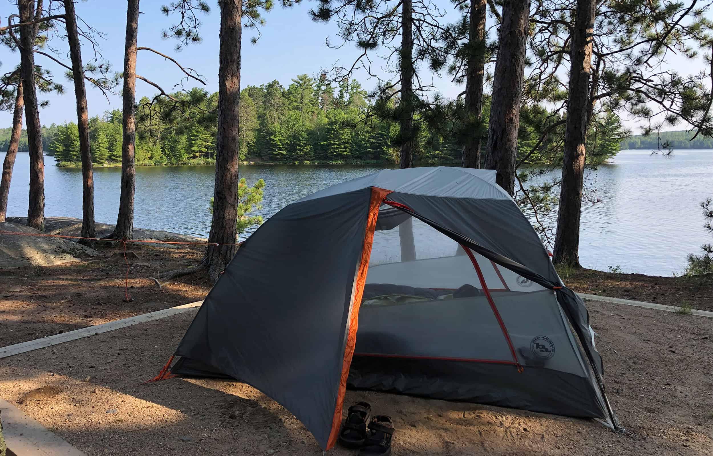 tent next to a mountain lake