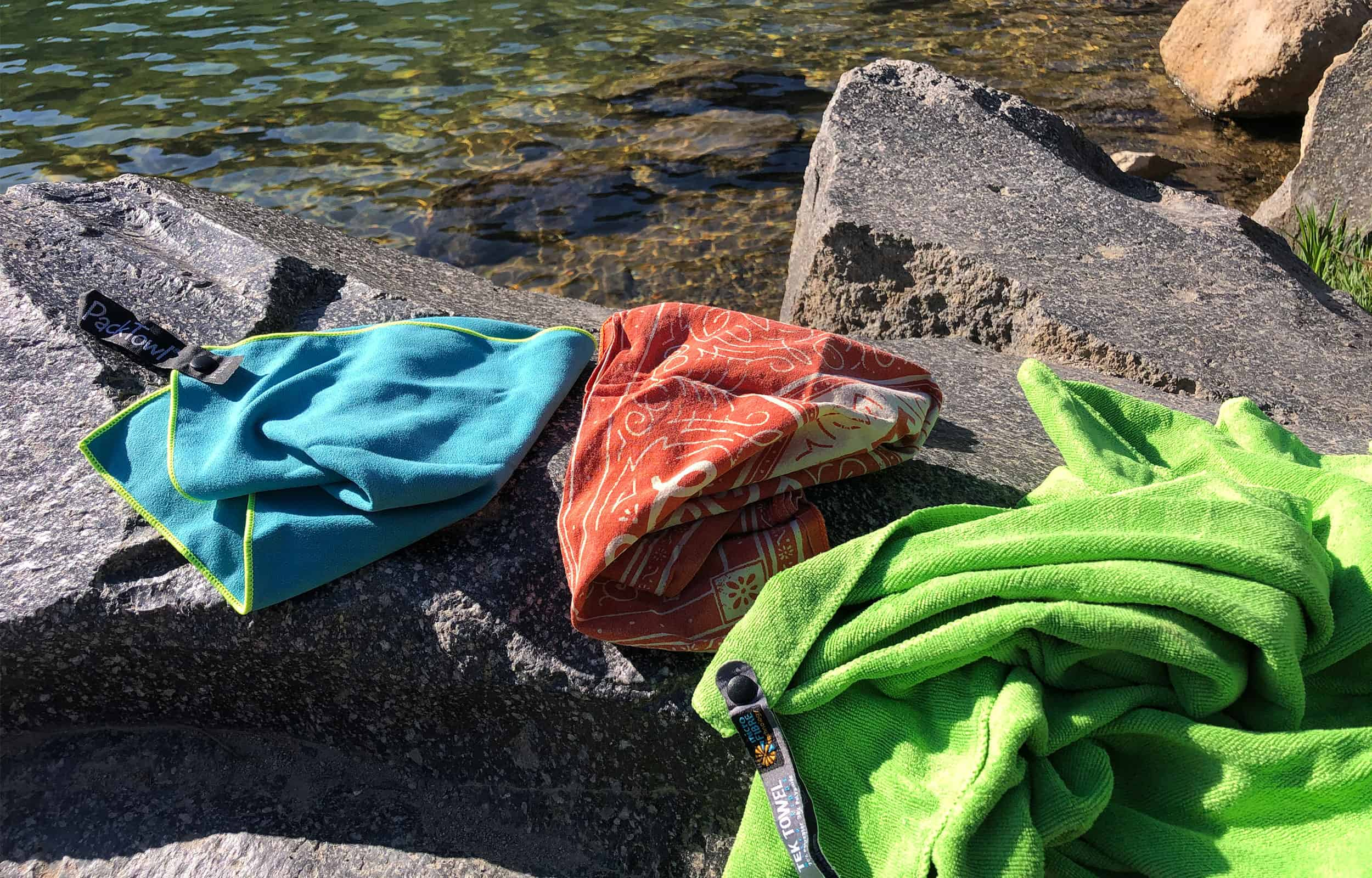 towels laying on a rock to stay clean while camping