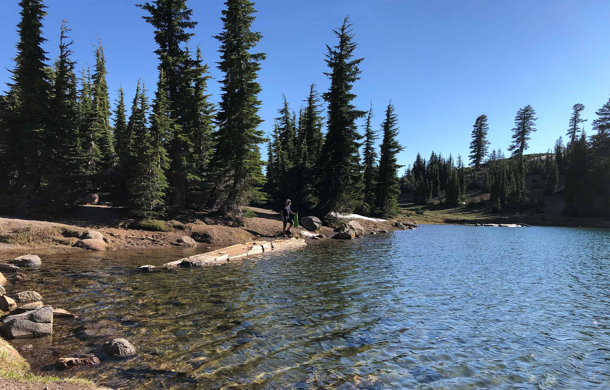 man getting in lake