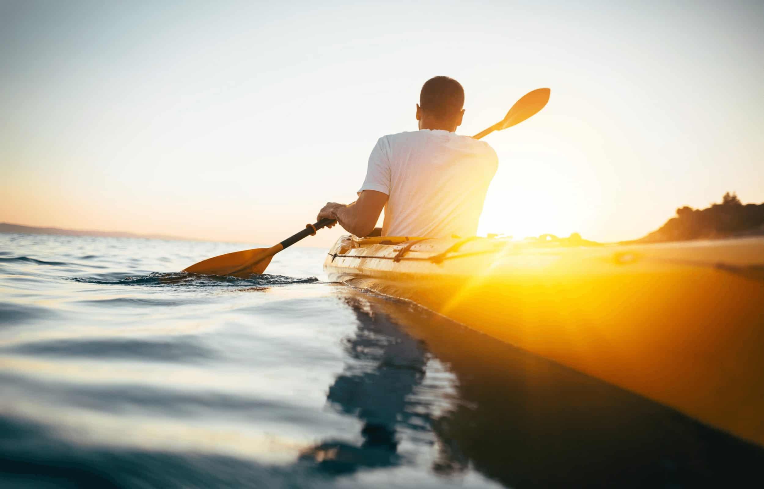 kayak man sunset