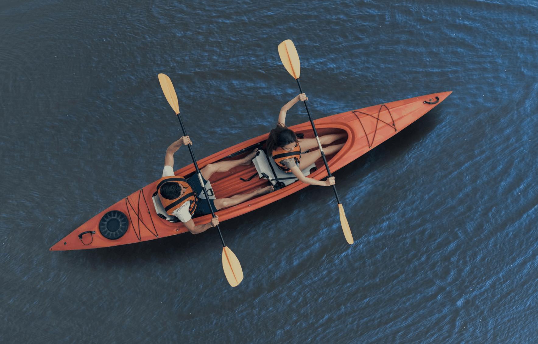 kayak couple ocean