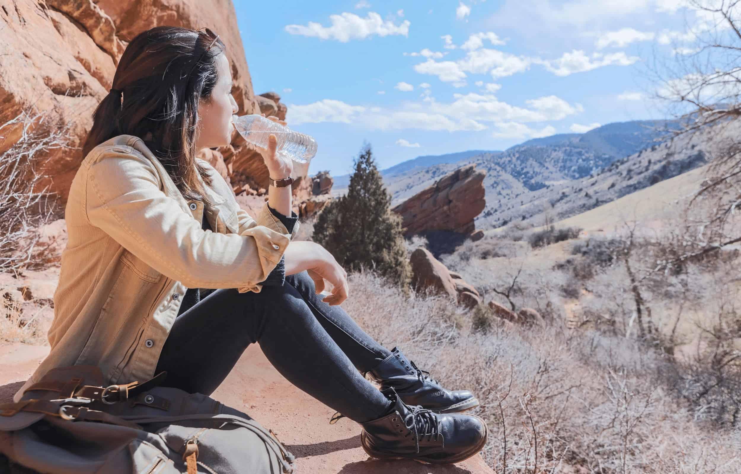 Girl hiking drinking water