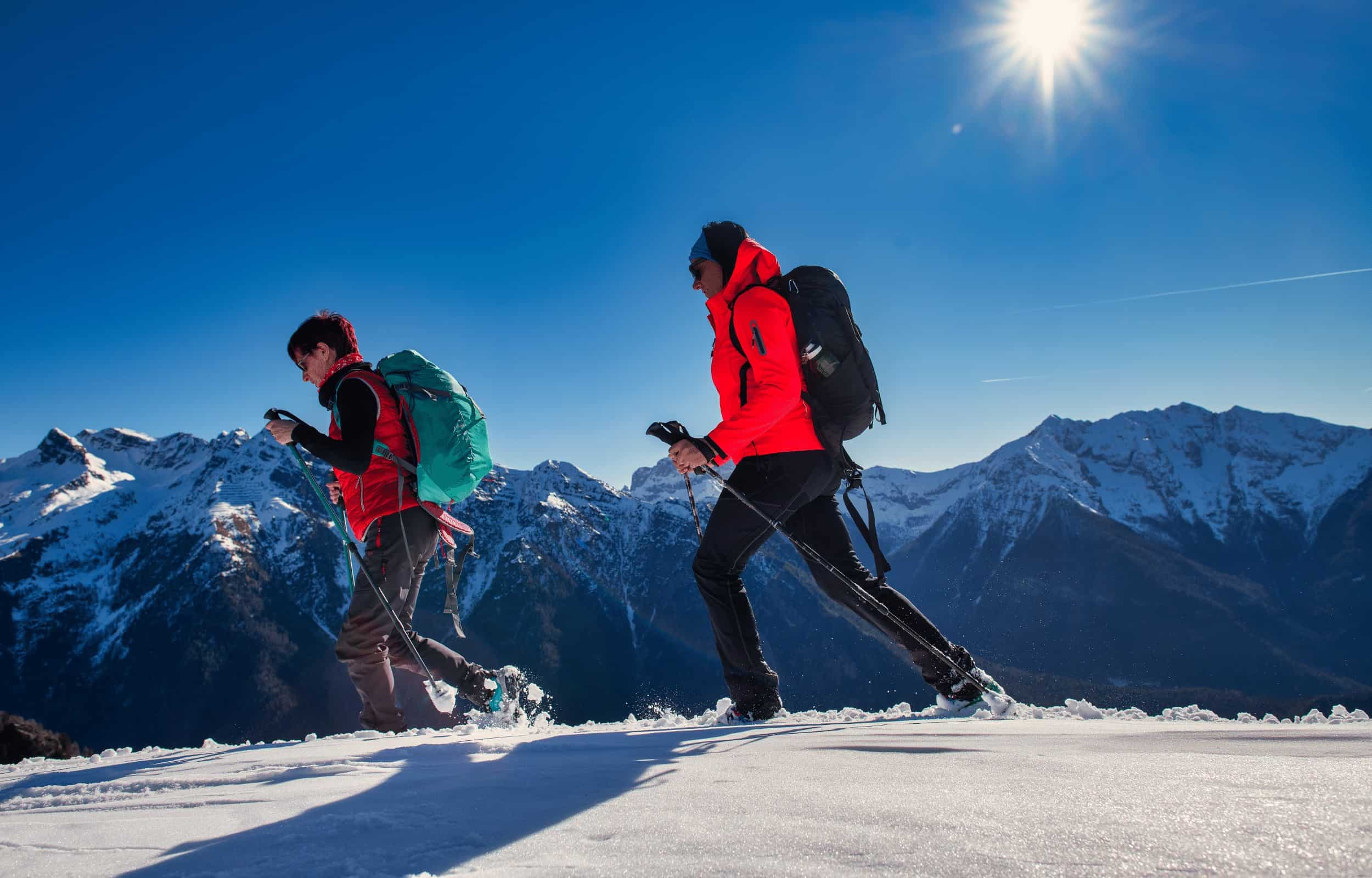 hiking mountains snow couple