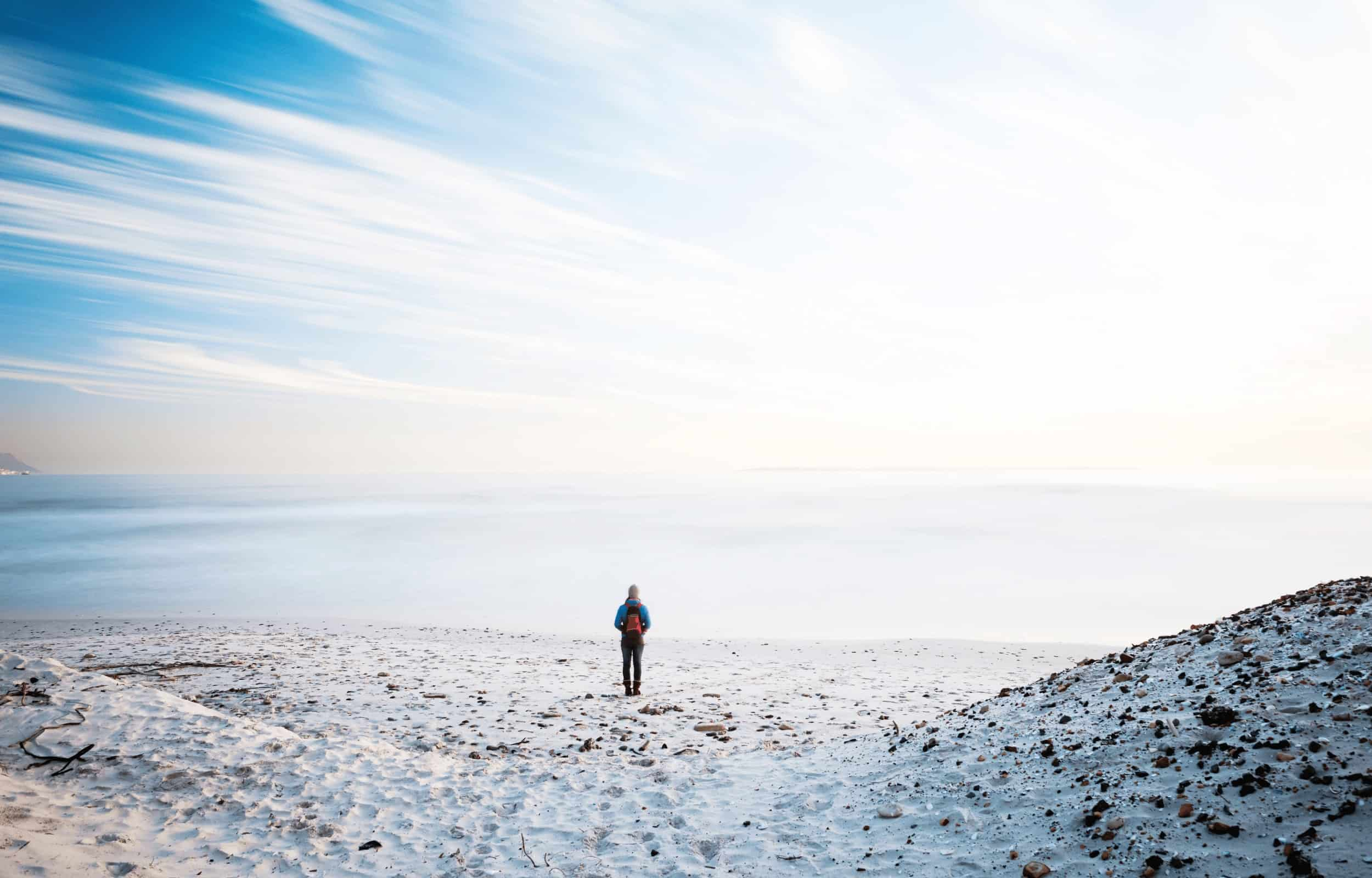 hiking alone beach solo hiker blue sky