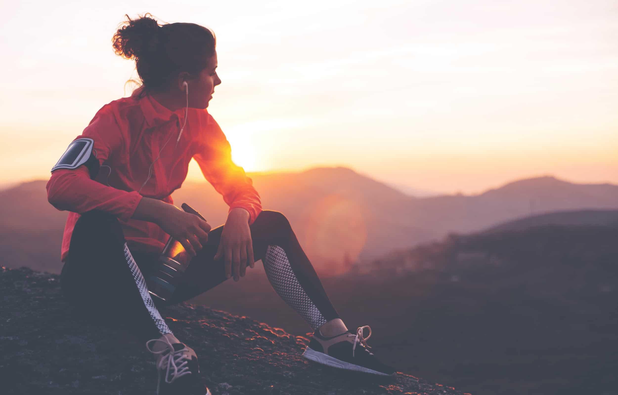 hiking alone solo hiking training girl red shirt sunrise